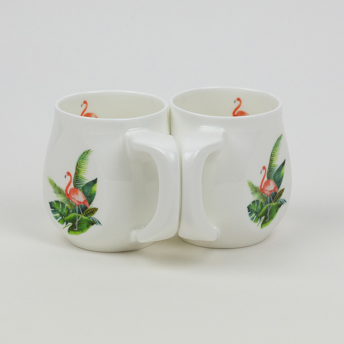 Two flamingo mugs made from fine bone china and mad in Britain.