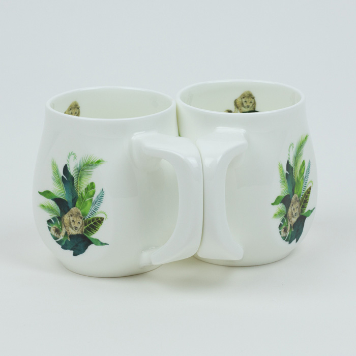 A pair of Leopard mugs made from fine bone china and mad in Britain.