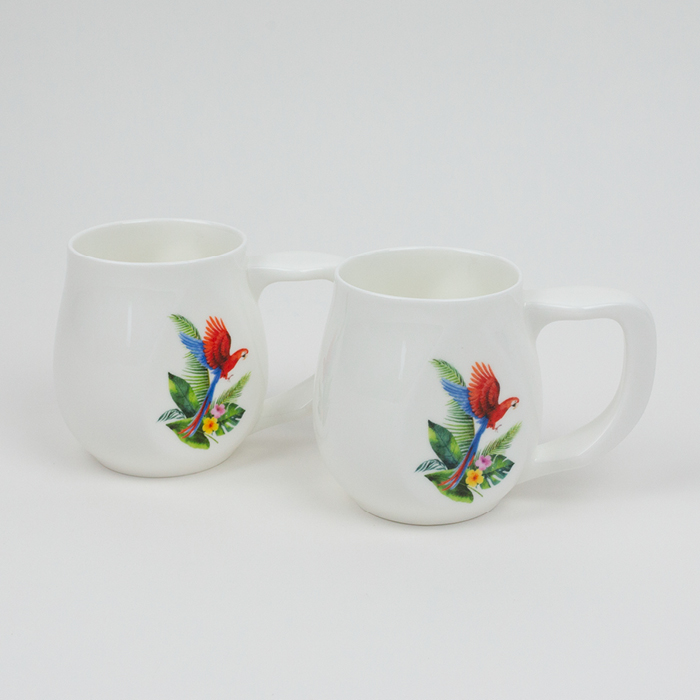 A pair of white fine bone china mugs with a colourful parrot printed on the side.