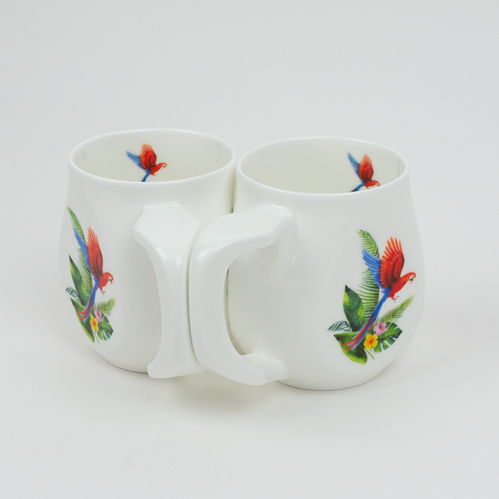 Two white fine bone china mugs with a colourful parrot printed on the side.