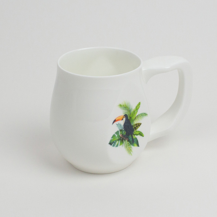 White fine bone china mug with a colourful toucan printed on the side.